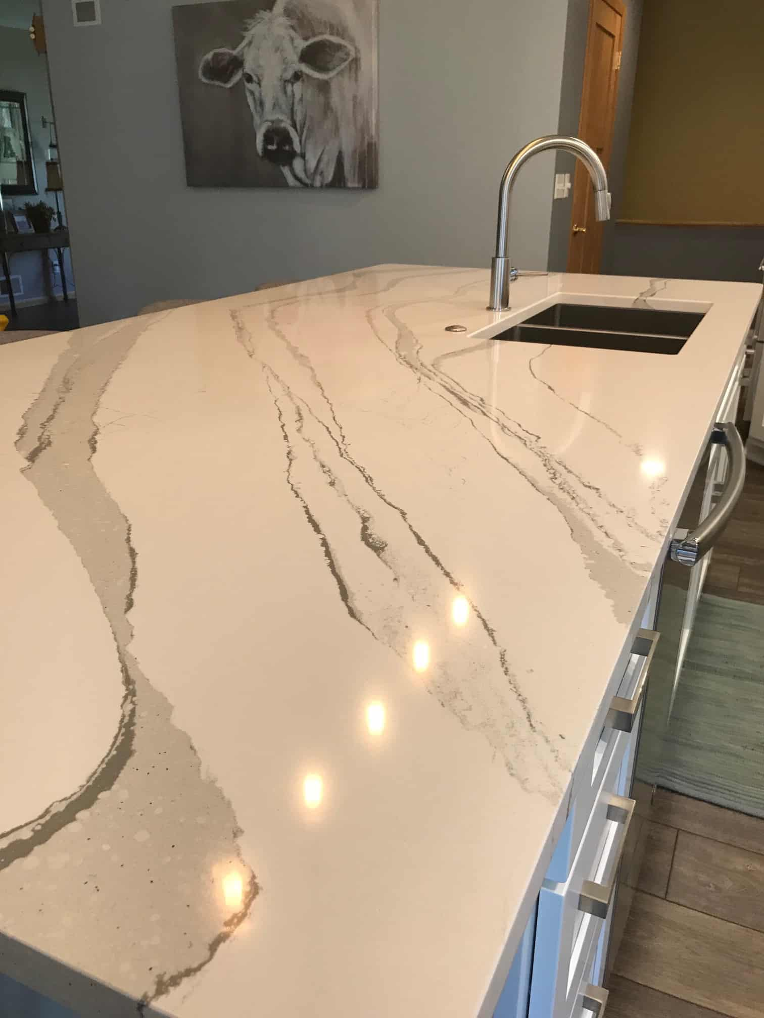 Sink in island with Brittanicca Cambria countertops