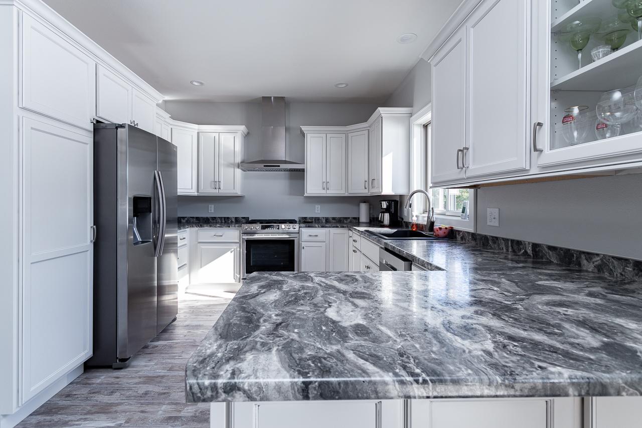 white kitchen with laminate countertop